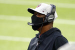 FILE - In this Oct. 18, 2020, file photo, Atlanta Falcons interim head coach Raheem Morris watches during the first half of an NFL football game against the Minnesota Vikings in Minneapolis. Morris says it is good to know he will be interviewed for the permanent job after the season. He says he considers his job performance and his regular conversations with team president Rich McKay and team owner Arthur Blank to be interviews for the job as he prepares for Sunday's game at Kansas City  (AP Photo/Bruce Kluckhohn, File)