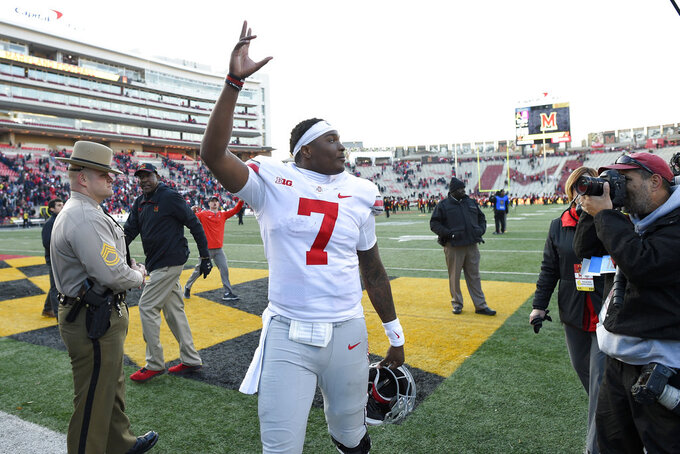 Ohio State quarterback Dwayne Haskins Jr. (7) waves to the stands as he leaves the field after an NCAA football game against Maryland, Saturday, Nov. 17, 2018, in College Park, Md. Ohio State won 52-51 in overtime. (AP Photo/Nick Wass)
