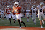 Texas running back Keaontay Ingram (26) scores a touchdown against Kansas State during an NCAA college football game Saturday, Nov. 9, 2019, in Austin, Texas. (Nick Wagner/Austin American-Statesman via AP)