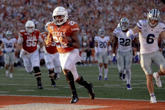 Texas running back Keaontay Ingram (26) scores a touchdown against Kansas State during an NCAA college football game Saturday, Nov. 9, 2019, in Austin, Texas. (Nick Wagner/Austin American-Statesman via AP)