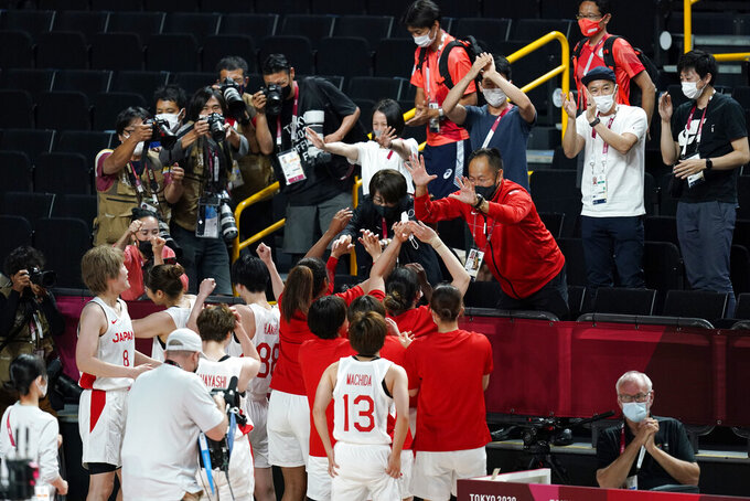 Japan players celebrate with fans after a women's basketball quarterfinal round game against Belgium at the 2020 Summer Olympics, Wednesday, Aug. 4, 2021, in Saitama, Japan. (AP Photo/Charlie Neibergall)