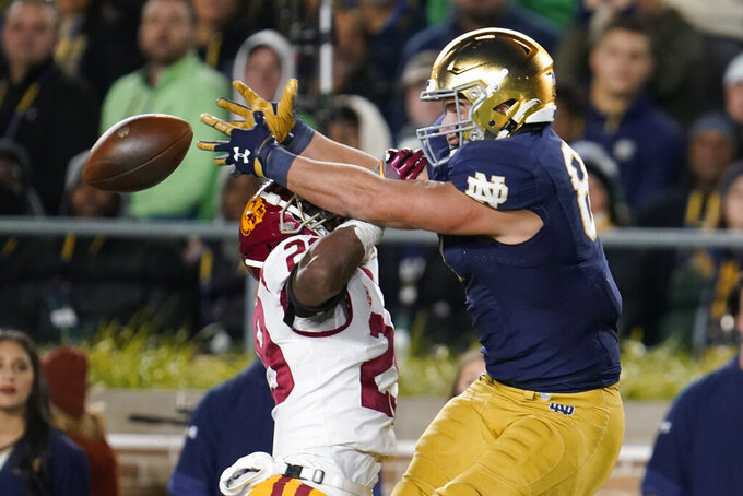 Southern California safety Xavion Alford (29) breaks up a pass intended for Notre Dame tight end Michael Mayer (87) in the first half of an NCAA college football game in South Bend, Ind., Saturday, Oct. 23, 2021. (AP Photo/Paul Sancya)