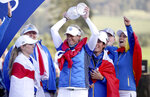 Team Europe's Suzann Pettersen, center, celebrates with her team and the trophy following Team Europe's victory in the Solheim Cup against the US at Gleneagles, Auchterarder, Scotland, Sunday, Sept. 15, 2019. (Ian Rutherford/PA via AP)