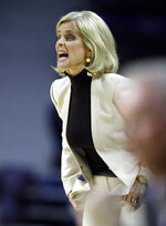 Baylor head coach Kim Mulkey yells to her team during the first half of an NCAA college basketball game against Kansas State in Manhattan, Kan., Wednesday, Feb. 13, 2019. (AP Photo/Orlin Wagner)