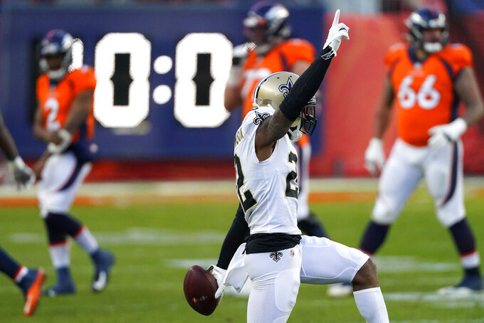 New Orleans Saints safety Chauncey Gardner-Johnson (22) celebrates his interception against the Denver Broncos during the second half of an NFL football game, Sunday, Nov. 29, 2020, in Denver. (AP Photo/Jack Dempsey)