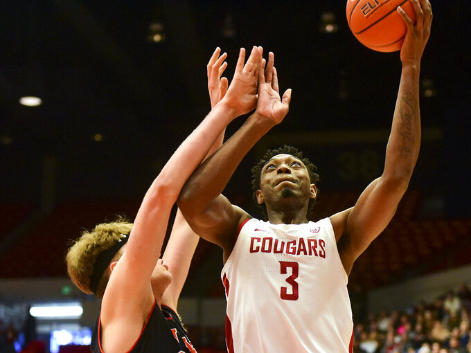 Washington State forward Robert Franks (3) shoots as Utah center Jayce Johnson defends during the first half of an NCAA college basketball game Saturday, Feb. 23, 2019, in Pullman, Wash. (Pete Caster/Lewiston Tribune via AP)