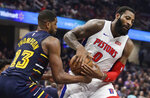 Detroit Pistons' Andre Drummond (0) drives past Cleveland Cavaliers' Tristan Thompson (13) in the second half of an NBA basketball game, Tuesday, Dec. 3, 2019, in Cleveland. Detroit won 127-94. (AP Photo/Tony Dejak)