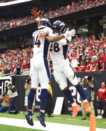 Denver Broncos running back Royce Freeman (28) celebrates his touchdown catch with teammate Courtland Sutton (14) during the first half of an NFL football game Sunday, Dec. 8, 2019, in Houston. (AP Photo/Eric Christian Smith)