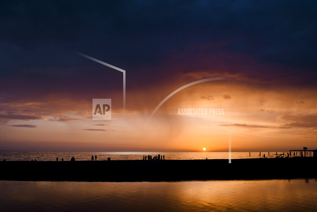 Russia, Sochi, rainfall over the sea at sunset