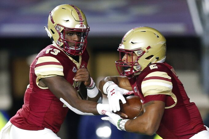 Boston College quarterback Anthony Brown (13) hands off to running back AJ Dillon (2) during the first half of an NCAA college football game in Boston, Friday, Oct. 26, 2018. (AP Photo/Michael Dwyer)