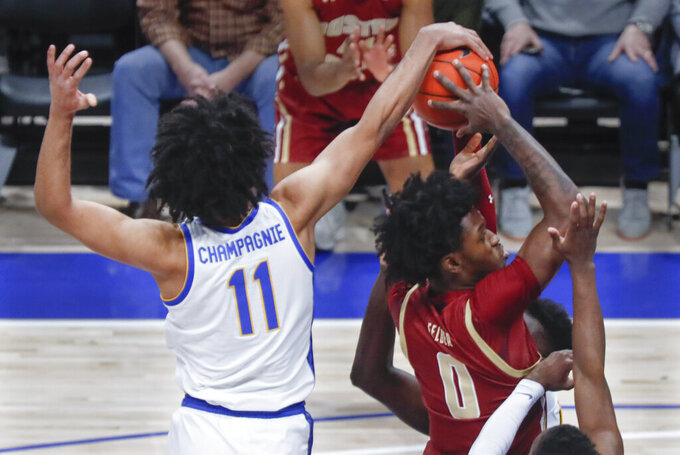 Pittsburgh's Justin Champagnie (11) blocks a shot buy Boston College's CJ Felder (0) during the first half of an NCAA college basketball game, Wednesday, Jan. 22, 2020, in Pittsburgh. (AP Photo/Keith Srakocic)