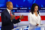 Democratic presidential candidate Sen. Cory Booker, D-N.J., speaks as Democratic presidential candidate Rep. Tulsi Gabbard, D-Hawaii, listens during a Democratic presidential primary debate, Wednesday, Nov. 20, 2019, in Atlanta. (AP Photo/John Bazemore)