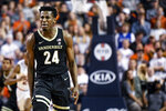 Vanderbilt forward Aaron Nesmith (24) celebrates after a basket against Auburn during the second half of an NCAA college basketball game Wednesday, Jan. 8, 2020, in Auburn, Ala. (AP Photo/Julie Bennett)