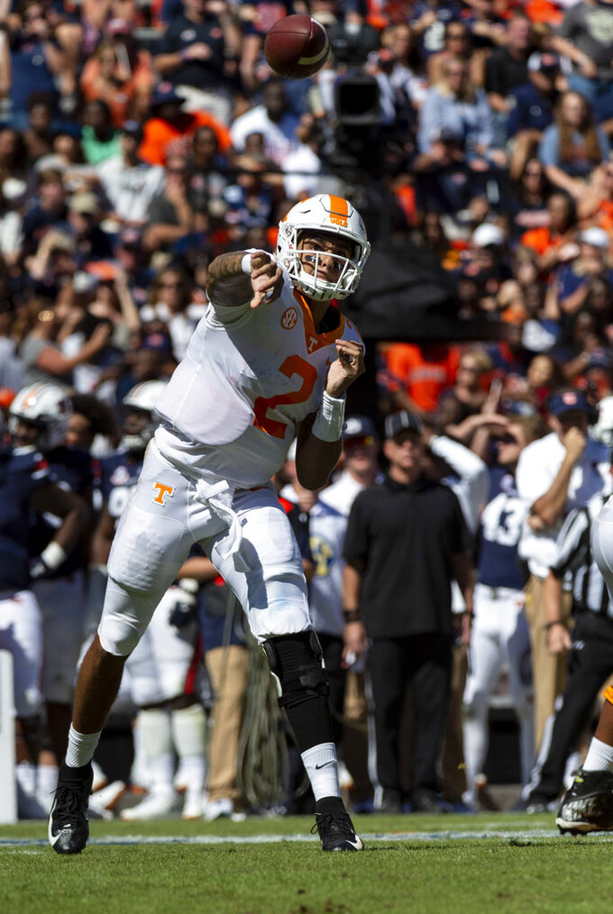Tennessee quarterback Jarrett Guarantano (2) throws to his sideline during the first half of an NCAA college football game against Auburn, Saturday, Oct. 13, 2018, in Auburn, Ala. (AP Photo/Vasha Hunt)