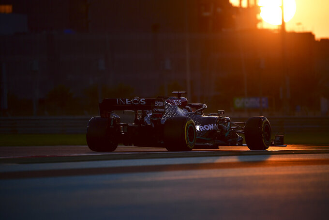 Mercedes driver Lewis Hamilton of Britain in action during second practice at the Formula One Abu Dhabi Grand Prix in Abu Dhabi, United Arab Emirates, Friday, Dec, 10, 2020. (Giuseppe Cacace, Pool via AP)