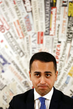 Deputy Premier and Labor Minister Luigi Di Maio listens to reporters' questions during a press conference at the Foreign Press Association headquarters, in Rome, Friday, Nov. 9, 2018. (AP Photo/Andrew Medichini)