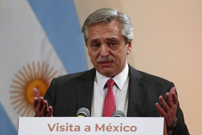 Argentina's President-elect Alberto Fernandez speaks to the press following a private meeting with Mexican President Andres Manuel Lopez Obrador, at the National Palace in Mexico City, Monday, Nov. 4, 2019.(AP Photo/Rebecca Blackwell)