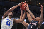 Memphis forward Precious Achiuwa (55) battles for a rebound with the Connecticut's Jalen Gaffney (1) during an NCAA college basketball game, Saturday, Feb. 1 2020, at the FedExForum in Memphis, Tenn. (Jim Weber/Daily Memphian via AP)