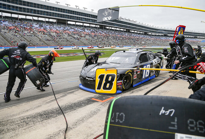 Kyle Busch's pit crew services his car during a NASCAR auto race at Texas Motor Speedway, Saturday, March 30, 2019, in Fort Worth, Texas. (AP Photo/Brandon Wade)