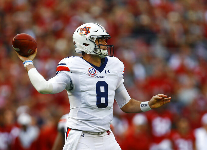 File-This Nov. 24, 2018, file photo shows Auburn quarterback Jarrett Stidham (8) throwing a pass against Alabama during the first half of an NCAA college football game in Tuscaloosa, Ala. he Purdue Boilermakers can finish off a season where their biggest win might just be keeping Jeff Brohm as coach in the Music City Bowl, while Auburn at least has Stidham playing one last game Friday, Dec. 28, 2018, before leaving for the NFL draft.(AP Photo/Butch Dill, File)