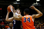 Gonzaga forward Filip Petrusev (3) shoots next to Pepperdine center Victor Ohia Obioha (34) during the second half of an NCAA college basketball game Saturday, Feb. 15, 2020, in Malibu, Calif. Pepperdine won 89-77. (AP Photo/Ringo H.W. Chiu)