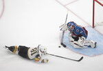 Colorado Avalanche goalie Philipp Grubauer (31) makes the save on Vegas Golden Knights' Jonathan Marchessault (81) during the third period of an NHL hockey playoff game in Edmonton, Alberta, Saturday, Aug. 8, 2020. (Jason Franson/The Canadian Press via AP)