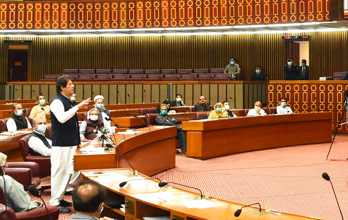 In this photo released by the Press Information Department, Pakistani Prime Minister addresses the Parliament in Islamabad, Pakistan, Thursday, June 25, 2020. Khan accused the United States on Thursday of having
