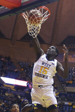 West Virginia forward Lamont West (15) dunks during the second half of an NCAA college basketball game against TCU Tuesday, Feb. 26, 2019, in Morgantown, W.Va. (AP Photo/Raymond Thompson)