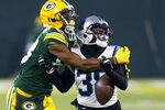 Carolina Panthers' Myles Hartsfield breaks up a pass intended for Green Bay Packers' Marquez Valdes-Scantling during the second half of an NFL football game Saturday, Dec. 19, 2020, in Green Bay, Wis. (AP Photo/Matt Ludtke)