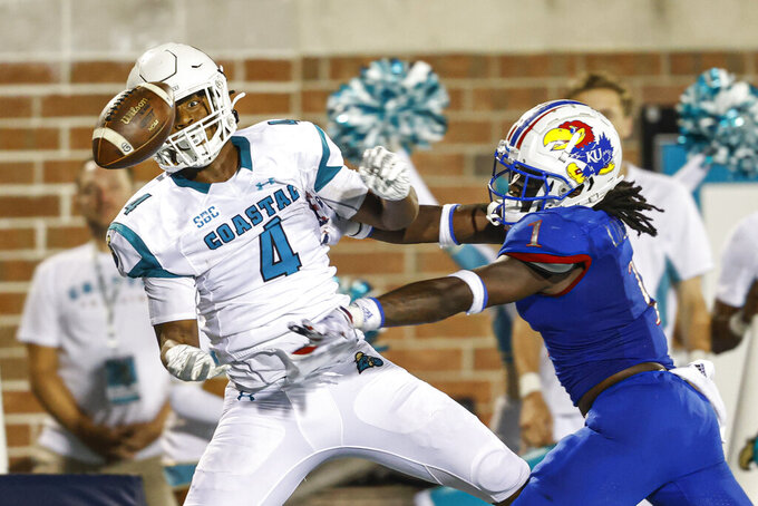 Kansas safety Kenny Logan Jr., right, breaks up a pass to Coastal Carolina tight end Isaiah Likely during the second half of an NCAA college football game in Conway, S.C., Friday, Sept. 10, 2021. Coastal Carolina won 49-22. (AP Photo/Nell Redmond)