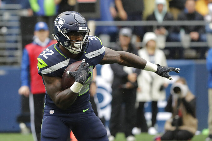 Seattle Seahawks' Chris Carson carries against the New Orleans Saints during the first half of an NFL football game Sunday, Sept. 22, 2019, in Seattle. (AP Photo/Ted S. Warren)