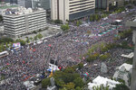 In this Thursday, Oct. 3, 2019 photo, thousands gather in downtown Seoul during a rally against South Korea's Justice Minister Cho Kuk in Seoul, South Korea. (Kim Seung-doo/Yonhap via AP)