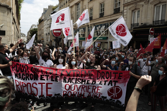 Demonstrators gather during a demonstration, Saturday, June 12, 2021 in Paris. Thousands of people rallied throughout France Saturday to protest against the far-right. (AP Photo/Lewis Joly)