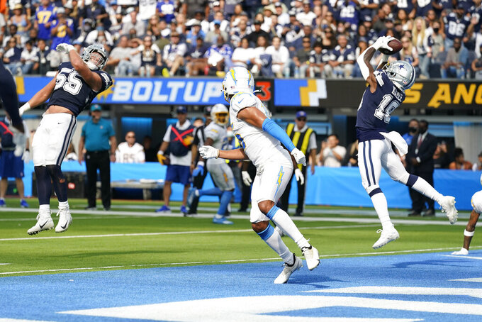 Dallas Cowboys strong safety Damontae Kazee, right, intercepts a pass against the Los Angeles Chargers during the second half of an NFL football game Sunday, Sept. 19, 2021, in Inglewood, Calif. (AP Photo/Gregory Bull)
