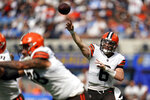 Cleveland Browns quarterback Baker Mayfield throws during the first half of an NFL football game against the Los Angeles Chargers Sunday, Oct. 10, 2021, in Inglewood, Calif. (AP Photo/Gregory Bull)