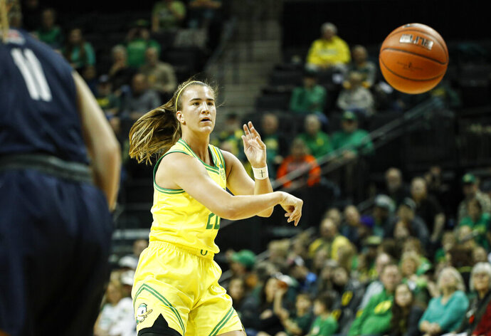 Oregon guard Sabrina Ionescu, passes against Corban in an exhibition college basketball game Saturday, Dec. 28, 2019, in Eugene, Ore. (AP Photo/Thomas Boyd)