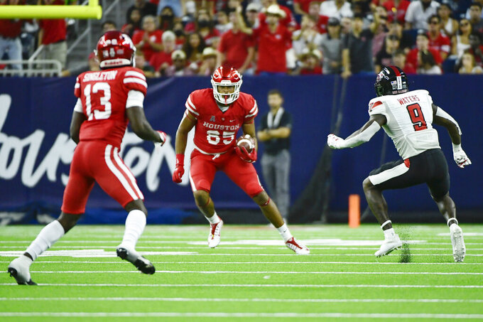 Houston tight end Christian Trahan (85) runs with the ball against Texas Tech during the first half of an NCAA college football game Saturday, Sept. 4, 2021, in Houston. (AP Photo/Justin Rex)
