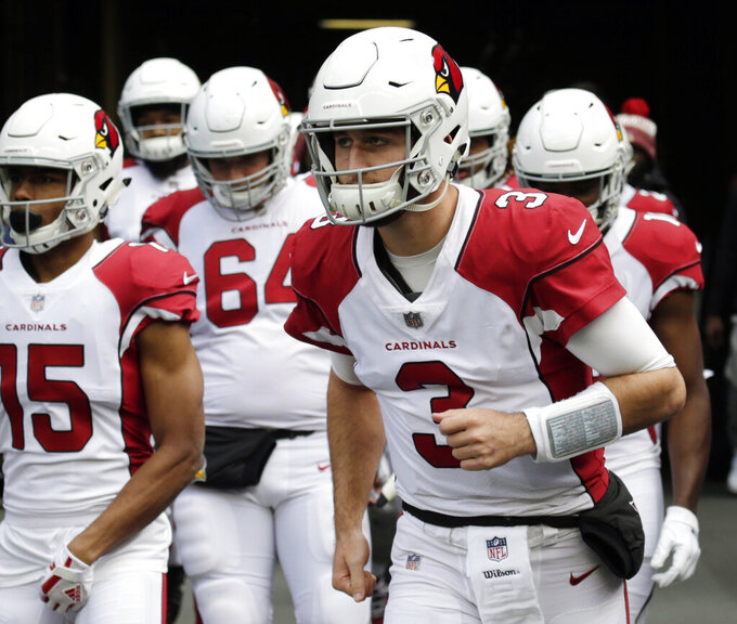FILE - In this Dec. 30, 2018, file photo, Arizona Cardinals quarterback Josh Rosen (3) leads his team onto the field to warm-up before an NFL football game against the Seattle Seahawks, in Seattle. Rosen has been involved in trade rumors all offseason. It hasn't stopped him from joining his teammates for voluntary workouts this week. (AP Photo/John Froschauer, File)