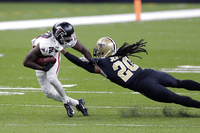 New Orleans Saints cornerback Janoris Jenkins (20) tries to tackle Atlanta Falcons wide receiver Calvin Ridley (18) in the first half of an NFL football game in New Orleans, Sunday, Nov. 22, 2020. (AP Photo/Brett Duke)