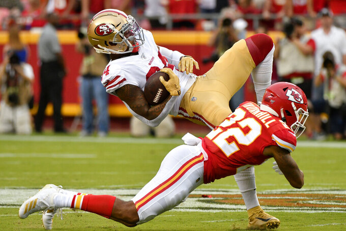 San Francisco 49ers wide receiver Kendrick Bourne (84) is tackled by Kansas City Chiefs cornerback Juan Thornhill (22) during the first half of an NFL preseason football game in Kansas City, Mo., Saturday, Aug. 24, 2019. (AP Photo/Ed Zurga)