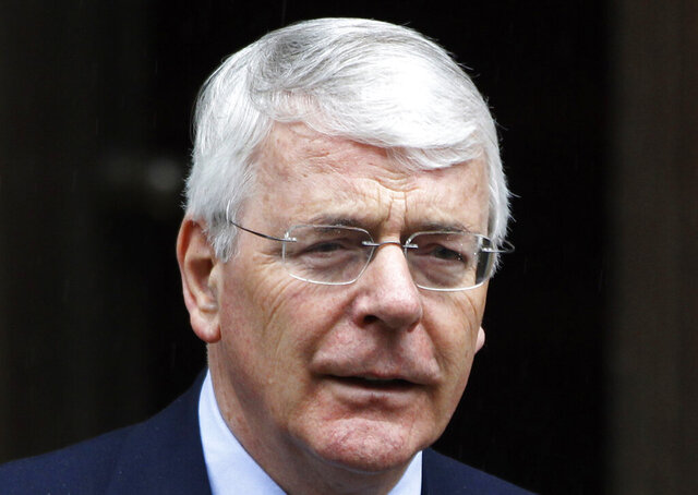 """FILE  - In this Tuesday, June 12, 2012 file photo, former British Prime Minister John Major arrives to give evidence to the Leveson inquiry at the Royal Courts of Justice in central London. For ex-British Prime Minister John Major, it was a no-brainer between the Olympics or cricket. While aids tried to persuade Major attending the 1996 games in Atlanta would be good for his """"street cred"""", he chose instead to watch cricket in London, missing the opportunity to see Britain's only gold Olympic medal that year. The details come as the UK government released a wave of archival records Tuesday, Dec. 31, 2019 following the law that certain records must be published thirty years after they were created. (AP Photo/Lefteris Pitarakis, File)"""