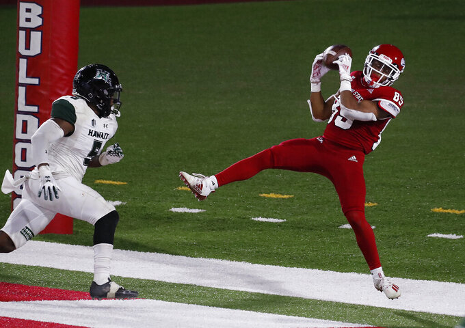 Fresno State wide receiver Erik Brooks tries to land inbounds against Hawaii defensive back Khoury Bethley during the second half of an NCAA college football game in Fresno, Calif., Saturday, Oct. 24, 2020. Hawaii won 34-19. (AP Photo/Gary Kazanjian)