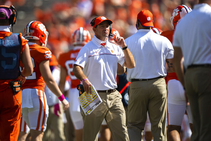Clemson head coach Dabo Swinney walks near the sideline during an NCAA college football game against Syracuse in Syracuse, S.C., on Saturday, Oct. 24, 2020. (Ken Ruinard/Pool Photo via AP)