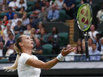 Slovakia's Magdalena Rybaikova tosses her racquet into the air after a shot to United States' Cori