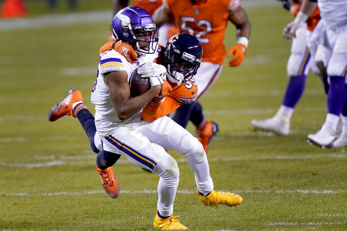 Minnesota Vikings wide receiver Justin Jefferson catches a pass as Chicago Bears safety Eddie Jackson (39) defends during the second half of an NFL football game Monday, Nov. 16, 2020, in Chicago. (AP Photo/Nam Y. Huh)