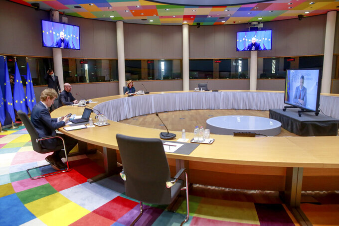 European Council President Charles Michel, second left, talks to Spanish Prime Minister Pedro Sanchez, right on a screen, during a video conference ahead of a EU summit at the European Council headquarters in Brussels, Wednesday, March 24, 2021. (Stephanie Lecocq, Photo Pool via AP)