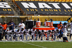 Members of the Denver Broncos kneel during the national anthem before an NFL football game against the Pittsburgh Steelers, Sunday, Sept. 20, 2020, in Pittsburgh. (AP Photo/Keith Srakocic)