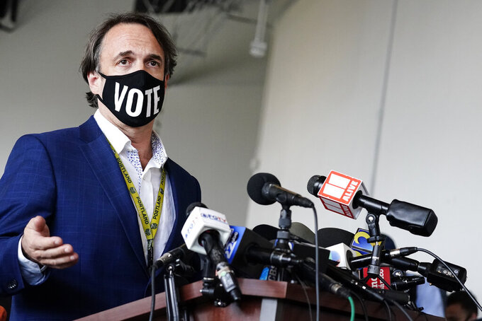 Fulton County Elections Director Richard Barron talks to the media about the ballot count for the general election at State Farm Arena on Thursday, Nov. 5, 2020, in Atlanta. (AP Photo/Brynn Anderson)