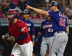 Minnesota Twins' Max Kepler, right, celebrates after scoring a run on a two-RBI doubt by Jorge Polanco in the seventh inning of a baseball game against the Cleveland Indians, Friday, July 12, 2019, in Cleveland. (AP Photo/David Dermer)