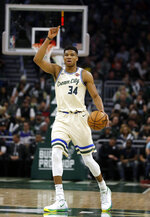 Milwaukee Bucks' Giannis Antetounmpo calls out a play against the New York Knicks during the second half of an NBA basketball game Monday, Dec. 2, 2019, in Milwaukee. (AP Photo/Jeffrey Phelps)